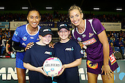 ANZ Future Captains Gabby Allerby aged 10 (L) and Madeleine Lord aged 12 (R) with Maria Tutaia of the Mystics and Laura Geitz of the Firebirds. 2015 ANZ Championship, Northern Mystics v Queensland Firebirds, The Trusts Arena, Auckland, New Zealand. 26 April 2015. Photo: Anthony Au-Yeung / www.photosport.co.nz
