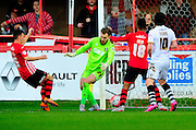 Port Vale's Jak Alnwick is beaten by a Exeter City's Jordan Tillson shot during the The FA Cup match between Exeter City and Port Vale at St James' Park, Exeter, England on 6 December 2015. Photo by Graham Hunt.