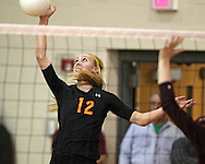 Solon's Jordan Smith (12) goes up for a kill during the WaMaC Tournament semifinal game at Mount Vernon High School in Mount Vernon on Thursday October 11, 2012. Solon defeated Mount Vernon 26-24, 25-22.