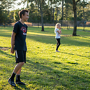 ROYAL PALM BEACH, FLORIDA, MARCH 15, 2017<br /> Tyler, 14, and Chloe Greaux, 8, watch their recently adopted dog &quot;Ginger&quot; run around in the dog park a short walk from their house. Their mother Cynthia Greaux is able to use vouchers to pay for their enrollment at a private school that specializes in educating children with dyslexia.<br /> (Photo by Angel Valentin/Freelance)
