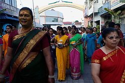 © Licensed to London News Pictures. 23/01/2016 Ipoh, Malaysia. Devotees carrying pots of milk walk ahead of  the chariot carrying the deity Lord Murugan on its way to the Kallumalai Murugan Temple in Ipoh, Malaysia, during the Thaipusam Festival, Saturday, Jan. 23, 2016. Photo credit : Sang Tan/LNP