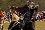 """A COUPLE OF MEN DRESSED LIKE THE """"HUNTER"""" AND THE BEAR DURING A TRADITIONAL DANCE AT THE HATUN LUYA FESTIVAL., .   The Hatun Luya is a festival celebrated every september 13th, where everyone from the surrounding areas comes together. During this festivity, you can witness demonstrations of popular customs."""