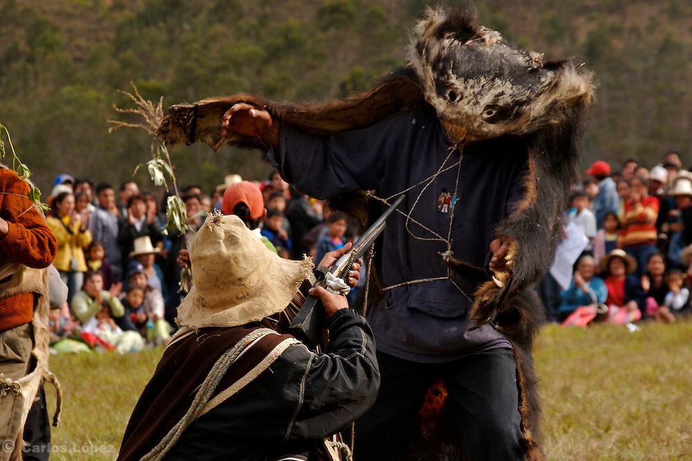 "A COUPLE OF MEN DRESSED LIKE THE ""HUNTER"" AND THE BEAR DURING A TRADITIONAL DANCE AT THE HATUN LUYA FESTIVAL., .   The Hatun Luya is a festival celebrated every september 13th, where everyone from the surrounding areas comes together. During this festivity, you can witness demonstrations of popular customs."