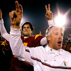 USC's Matt Leinart,11, and coach Pete Carroll celebrates after USC beat Stanford 51-2. Stanford vs USC at the Los Angeles Memorial Coliseum November 5. 2005.
