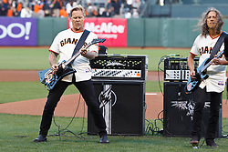 SAN FRANCISCO, CA - MAY 03:  Recording artists James Hetfield (left) and Kirk Hammett (right) of Metallica performs the national anthem before the game between the San Francisco Giants and the Los Angeles Dodgers at AT&T Park on May 3, 2013 in San Francisco, California. The San Francisco Giants defeated the Los Angeles Dodgers 2-1. (Photo by Jason O. Watson/Getty Images) *** Local Caption *** James Hetfield; Kirk Hammett