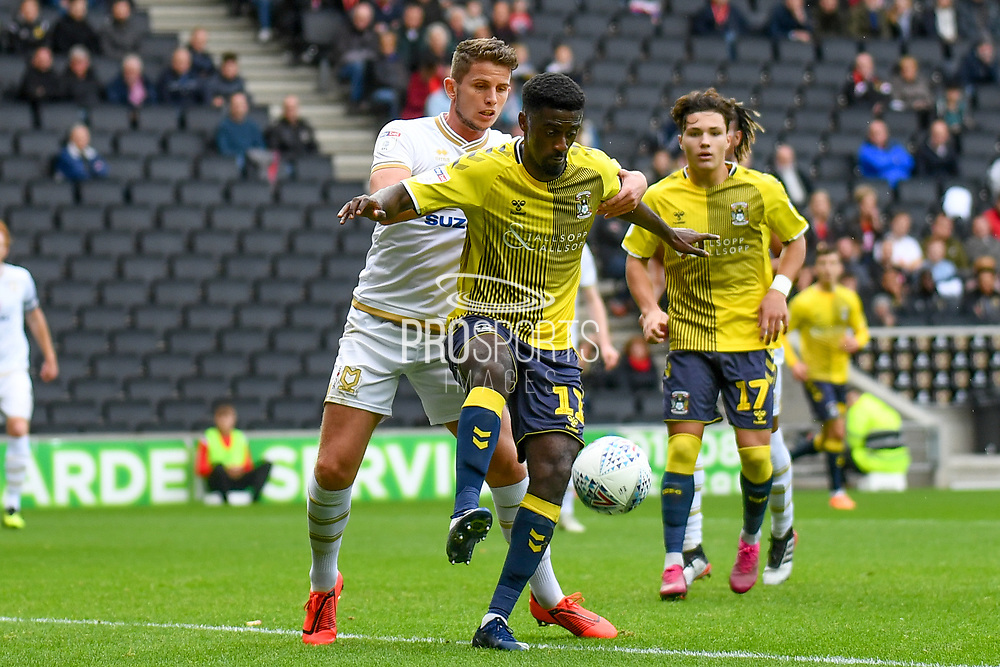 Coventry City striker Jordi Hiwula-Mayifuila  (11) battles for possession  with Milton Keynes Dons midfielder Jordan Houghton (24) during the EFL Sky Bet League 1 match between Milton Keynes Dons and Coventry City at stadium:mk, Milton Keynes, England on 19 October 2019.