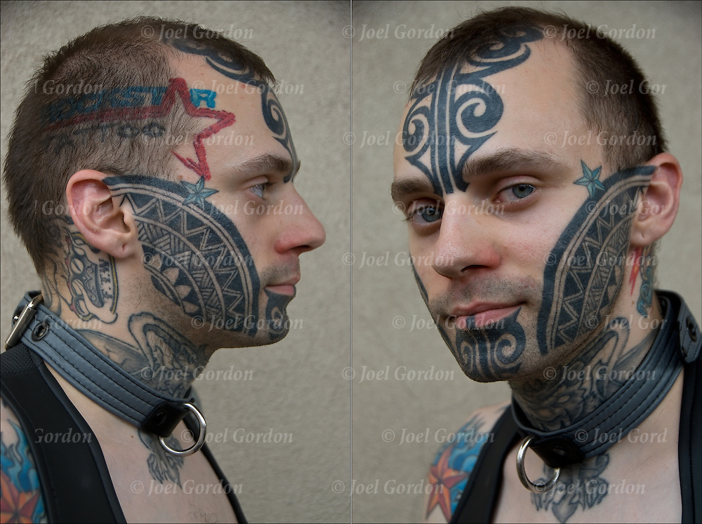 Ryan Vitiello's face and body tattoos were photographed at the Folsom Street East, S&amp;M Street Fair in New York Cilty. <br /> <br /> &quot;The face tattoos are inspired by M?ori/ Polynesian tattooing but are not what they would traditionally do. The stuff on my hands and arms and some on my neck are automotive inspired with allot of car parts in them. (I work as a mechanic and like cars so they seem fitting).&quot;<br /> <br /> Body art or tattoos has entered the mainstream it is known longer considered a weird kind of subculture.