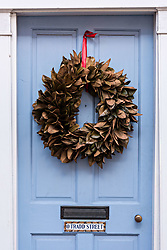 December 21, 2017 - Charleston, South Carolina, United States of America - A blue wooden door of a historic home decorated with a Magnolia leaf Christmas wreath at 0 Tradd Street in Charleston, SC. (Credit Image: © Richard Ellis via ZUMA Wire)