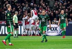 21-01-2018 NED: AFC Ajax - Feyenoord, Amsterdam<br /> Ajax was met 2-0 te sterk voor Feyenoord / Teleurstelling bij Jens Toornstra #28 of Feyenoord als Donny van de Beek #6 of AFC Ajax de 1-0 binnenschiet