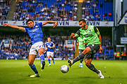 AFC Wimbledon defender Rod McDonald (4) crosses the ball during the EFL Sky Bet League 1 match between Ipswich Town and AFC Wimbledon at Portman Road, Ipswich, England on 20 August 2019.