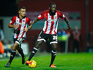 Nico Yennaris of Brentford and Toumani Diagouraga of Brentford during the Sky Bet Championship match between Brentford and Hull City at Griffin Park, London<br /> Picture by Mark D Fuller/Focus Images Ltd +44 7774 216216<br /> 03/11/2015