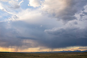 A rain storm passes before the western slope of the Wind River Mountains in Wyoming