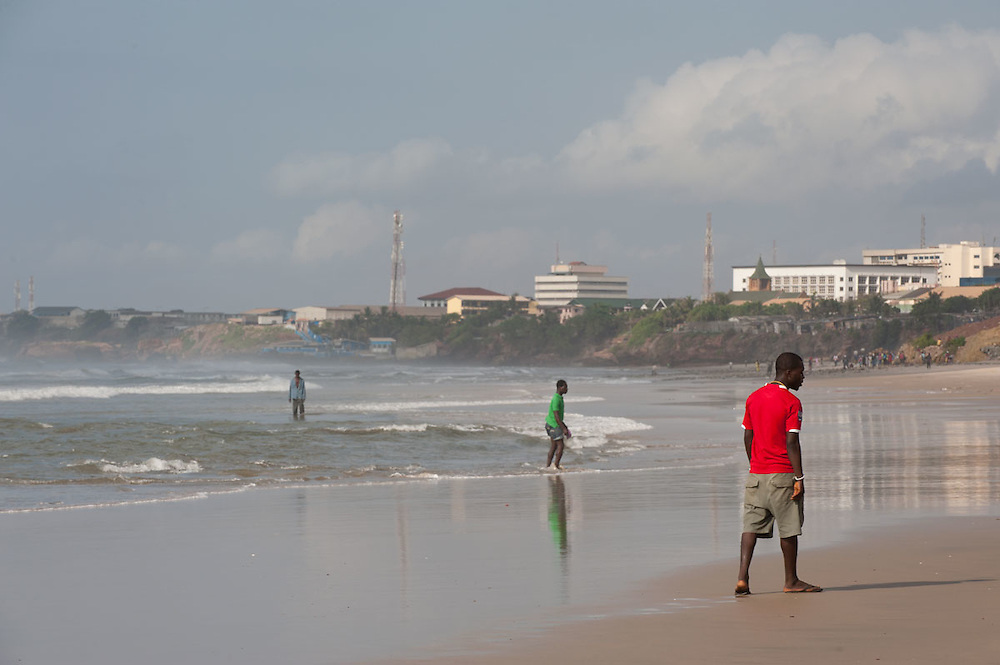 People walking on the beach in front of Independence Square, Accra, Ghana 2011