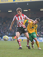 Saturday February 20th 2010: Norwich City 's Wes Hoolahan challenges Southampton's Dean Hammond at the Canaries home ground Carrow road.(Pic by Rob Colman Focus Images)