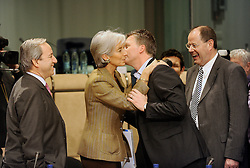 Christine Lagarde, France's finance minister, center left, is greeted by Wouter Bos, the Netherlands's finance minister, center right, as Yeoryios Alogoskoufis, Greece's finance minister, far left, and Peer Steinbrueck, Germany's finance minister, far right, look on, during the EuroGroup conference, a meeting of finance ministers from the euro zone, Monday, Dec. 1, 2008, in Brussels, Belgium.  (Photo © Jock Fistick)