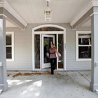 TAMPA, FL -- March 22, 2011 -- Shannon Moore, broker/owner of Green Lion Realty, enters a vacant home in North Port, Fla., 2011.  A recent study showed that one and five homes in the state of Florida is vacant.