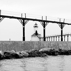 Michigan City lighthouse black and white photo. The Michigan City East Pierhead Lighthouse is located in Michigan City, Indiana along the Lake Michigan shoreline.