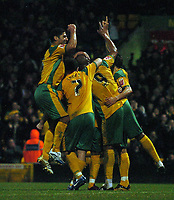 Photo: Ashley Pickering.<br />Norwich City v Queens Park Rangers. Coca Cola Championship. 30/12/2006.<br />Dion Dublin (no. 9) is mobbed by team mates after scoring Norwich's only goal