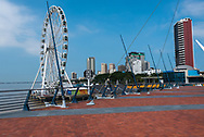 Guayaquil, Ecuador--April 15, 2018.  A ferris wheel and skyscraper apartment buildings are prominent on the promenade Guayaquil promenade. Editorial use only.