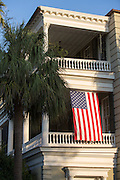 Stately antebellum historic home with double porches known as piazzas along the High Battery in Charleston, SC.