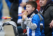 Ayoung Albion fan tucks into a hotdog during the Sky Bet Championship match between Brighton and Hove Albion and Charlton Athletic at the American Express Community Stadium, Brighton and Hove, England on 5 December 2015. Photo by Bennett Dean.
