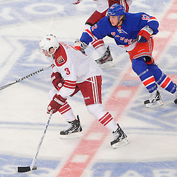 New York Rangers left wing Carl Hagelin (62) pursues Phoenix Coyotes defenseman Keith Yandle (3) through center ice during second period NHL action between the Phoenix Coyotes and the New York Rangers at Madison Square Garden.