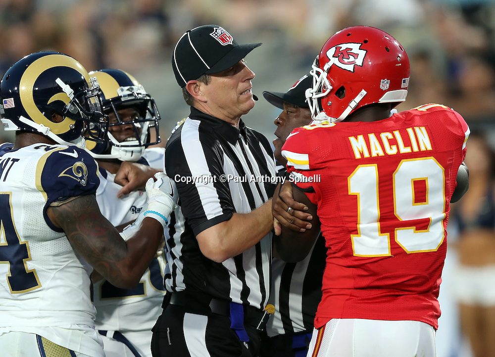 An NFL official restrains Kansas City Chiefs wide receiver Jeremy Maclin (19) while breaking up a fight between Maclin and Los Angeles Rams cornerback Lamarcus Joyner (20), both of whom were ejected from the game, during the 2016 NFL preseason football game against the Los Angeles Rams on Saturday, Aug. 20, 2016 in Los Angeles. The Rams won the game 21-20. (©Paul Anthony Spinelli)