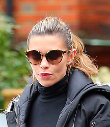 Model Abbey Clancy wearing a fur hooded jacket, cropped polo-neck top, black leggings and trainers on her way to Strictly Come Dancing rehearsals in London, UK. 17/12/2013<br />BYLINE MUST READ : JAMESY/GOTCHA IMAGES<br /><br />Copyright by © Gotcha Images Ltd. All rights reserved.<br />Usage of this image is conditional upon the acceptance <br />of Gotcha Images Ltd, terms and conditions available at<br />www.gotchaimages.com