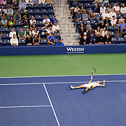 August 30, 2017 - New York, NY : Alexander Zverev, in white, collapses after lunging for a shot during his matchup against Borna Coric, not visible, in the Grandstand on the third day of the U.S. Open, at the USTA Billie Jean King National Tennis Center in Queens, New York, on Wednesday. <br /> CREDIT : Karsten Moran for The New York Times
