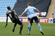 Bury Striker Leon Clarke getting close attention from Coventry City Defender Jack Stephens during the Sky Bet League 1 match between Coventry City and Bury at the Ricoh Arena, Coventry, England on 13 February 2016. Photo by Chris Wynne.