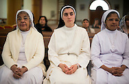 Nuns praying at the Saint Joseph Chaldean church. The majority of Iraq's Christians belong to the Chaldean Catholic church. Iraq's Christian community is considered one of the longest continues Christian communities in the world. In 2003 there were an estimated 1.5 million Christians in Iraq. Today, Iraqi Christians are thought to number approximately 400,000. Violence, persecution and sectarian strife have forced more than two thirds of the Christian population to flee the country.  Ainkawa, Iraq. 17/04/2014.