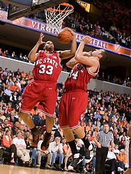 North Carolina State forward Brandon Costner (33) and forward/center Ben McCauley (34) go up for a rebound against UVA.  The Virginia Cavaliers men's basketball team defeated the North Carolina State Wolfpack 78-60 at the John Paul Jones Arena in Charlottesville, VA on February 24, 2008.