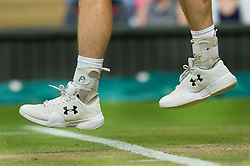 LONDON, ENGLAND - Saturday, July 2, 2016:  Andy Murray and his shoes with his wedding ring tied to his shoe laces  (GBR) during the Gentlemen's Single 3rd Round match on day six of the Wimbledon Lawn Tennis Championships at the All England Lawn Tennis and Croquet Club. (Pic by Kirsten Holst/Propaganda)