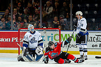 KELOWNA, BC - NOVEMBER 6:  Mark Liwiski #9 of the Kelowna Rockets is tripped up by Nolan Jones #15 as Brock Gould #33 of the Victoria Royals misses a second period save at Prospera Place on November 6, 2019 in Kelowna, Canada. (Photo by Marissa Baecker/Shoot the Breeze)
