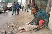 8/8/01 -- (PHOTO BY MIKE FENDER) w/ story, slug: AFRICA, file: 62040 // Fasika, with her brother Yakob on her back, begs on the streets of Addis Ababa during the day along with other children of the street. The girl and other kids are not afraid to approach people asking for money.