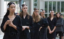 © Licensed to London News Pictures. 13/09/2014. London, England. Models listening to Julien Macdonald's instructions before the Julien Macdonald London Fashion Week catwalk show at the Royal Opera House. Photo credit: LNP
