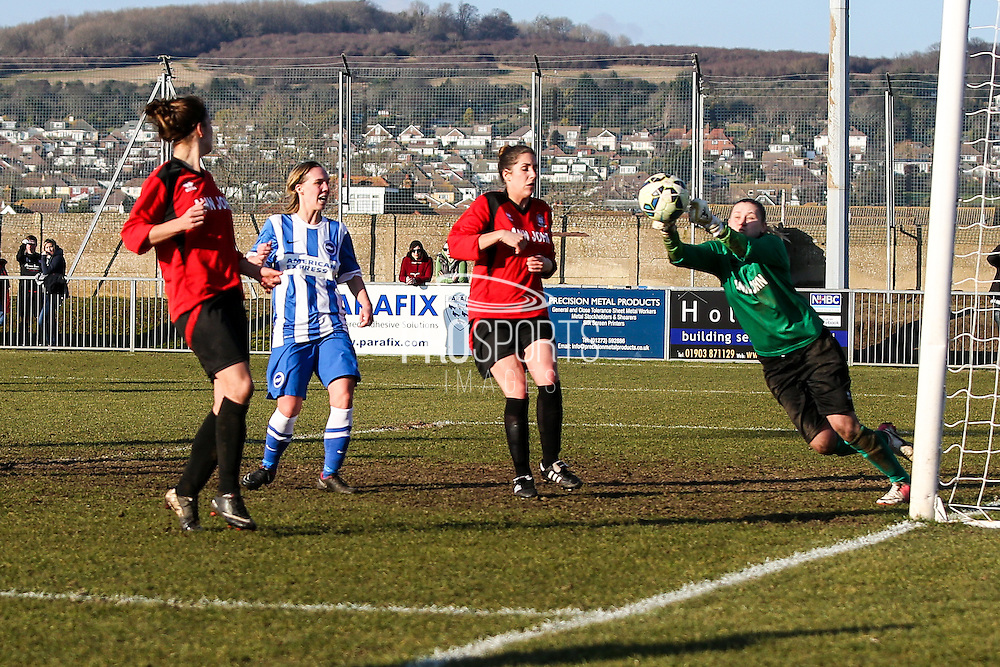 Hassocks keeper Lauren Dolbear punches to clear during the FA Women's Sussex Challenge Cup semi-final match between Brighton Ladies and Hassocks Ladies FC at Culver Road, Lancing, United Kingdom on 15 February 2015. Photo by Geoff Penn.