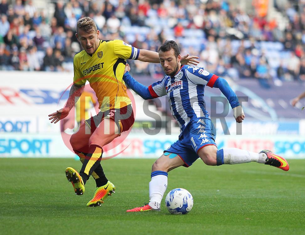Adam Le Fondre of Wigan Athletic (R) has a shot at goal - Mandatory by-line: Jack Phillips/JMP - 15/10/2016 - FOOTBALL - DW Stadium - Wigan, England - Wigan Athletic v Burton Albion - EFL Championship