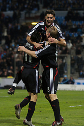 MARSEILLE, FRANCE - Tuesday, December 11, 2007: Liverpool's Dirk Kuyt (R) celebrates scoring the third goal against Olympique de Marseille with team-mates Alvaro Arbeloa and Yossi Benayoun during the final UEFA Champions League Group A match at the Stade Velodrome. (Photo by David Rawcliffe/Propaganda)