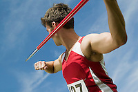 Male athlete holding javelin
