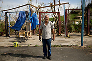 CAGUAS, PUERTO RICO - OCTOBER 10, 2017 - Ismael Del Valle stands in front of what remains of his son&rsquo;s detroyed car repair shop on road PR-763 in Caguas, Puerto Rico, where the center of Hurricane Maria cause some of the most extensive damage .(Photo/Jos&eacute; Jim&eacute;nez) Through the Iris of Hurricane Mar&iacute;a<br />