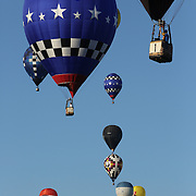 USA pilot Johnny Petrehn (front) and other hot air balloons in the skies around rural Michigan near Battle Creek as they reach a target area during competition in the 20th FAI World Hot Air Ballooning Championships. Battle Creek, Michigan, USA. 22nd August 2012. Photo Tim Clayton