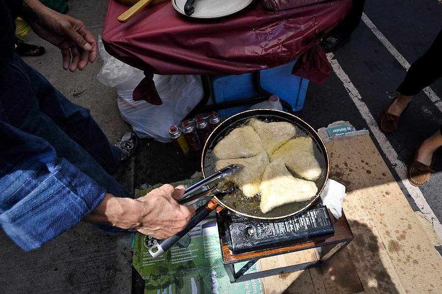 Indonesian Food Bazaar, Frying Pempek goreng (king fish) South Sumatra style