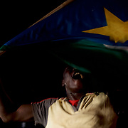 A man waves the South Sudan flag, in central juba, during celebrations for the independence of South Sudan.