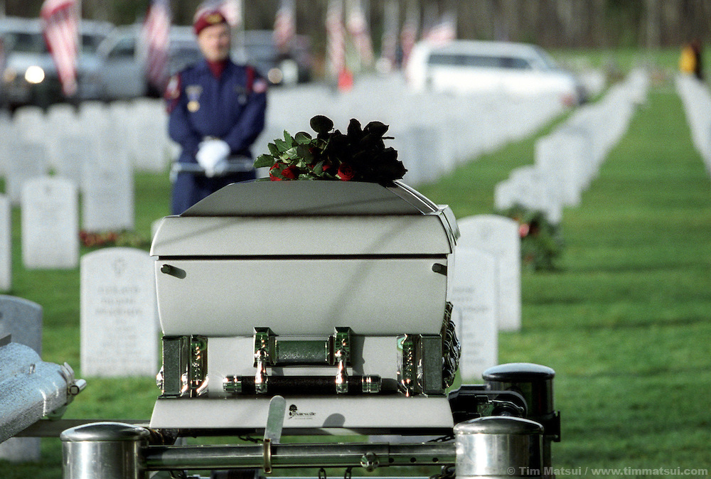 The casket of Sgt. 1st. Class Nathan Chapman awaits burial after ceremonies at the Tahoma National Cemetery in Kent, Washington, on Friday, January 1, 2002. Chapman was the first U.S. soldier to be killed by hostile fire in Afghanistan since ground troops were committed. He died on January 4, 2002..