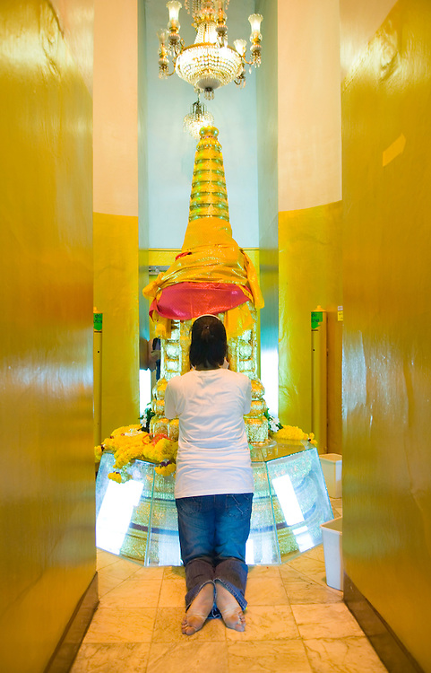 Woman worshiping in Buddhist shrine inside the Golden Mount Wat Saket Bangkok, Thailand&amp;#xA;<br />