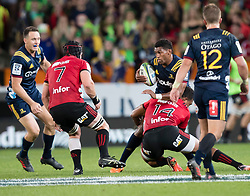 Highlanders' Waisake Naholo, centre, is tackled by Crusaders' Seta Tamanivalu in the Super Rugby match, Forsyth Barr Stadium, Dunedin, New Zealand, Saturday, March 17, 2018. Credit:SNPA / Adam Binns ** NO ARCHIVING**