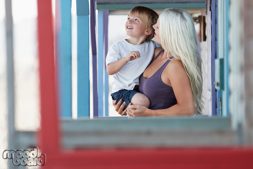 Young mother with son (3-4) on outdoor porch