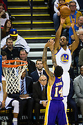 Golden State Warriors forward Andre Iguodala (9) shoots a jumper over the Los Angeles Lakers at Oracle Arena in Oakland, Calif., on November 23, 2016. (Stan Olszewski/Special to S.F. Examiner)