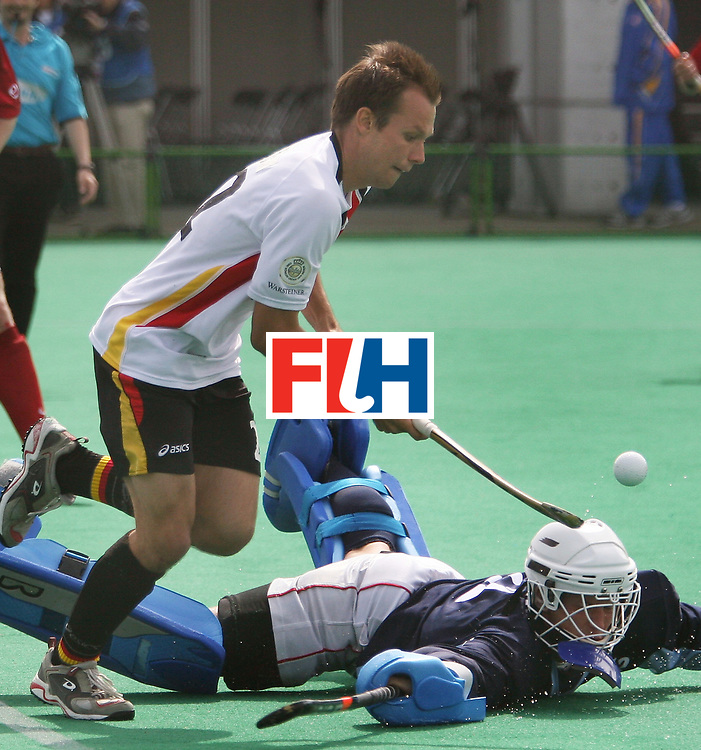 Kakamigahara (Japan): Matthias Witthaus of Germany had Arkadiusz Matuszak, the Poland Goal keeper under his mercy in the Olympic Hockey Qualifier at Gifu Perfectural Green Stadium at Kakamigahara on 12 April 2008. Germany beat Poland 5-0. <br /> Photo: GNN/ Vino John